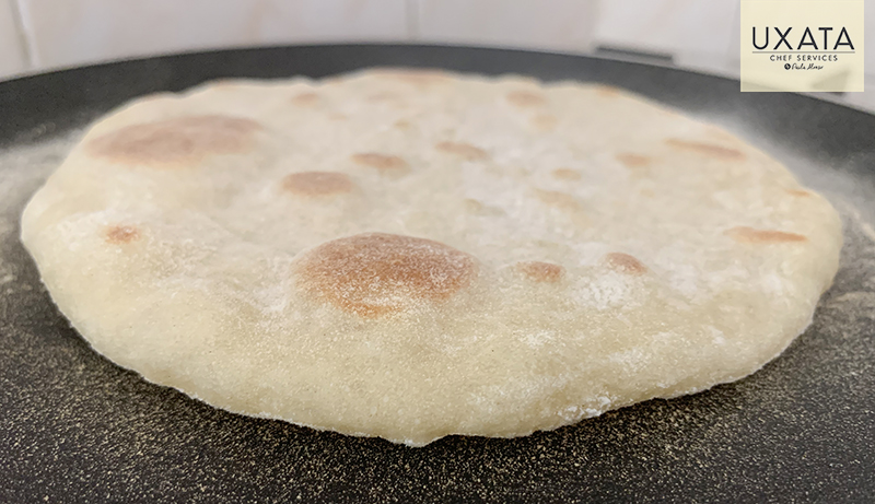 Freshly homemade pita bread, by UXATA Private Chef Services, in Caleta Tankah, Riviera Maya.