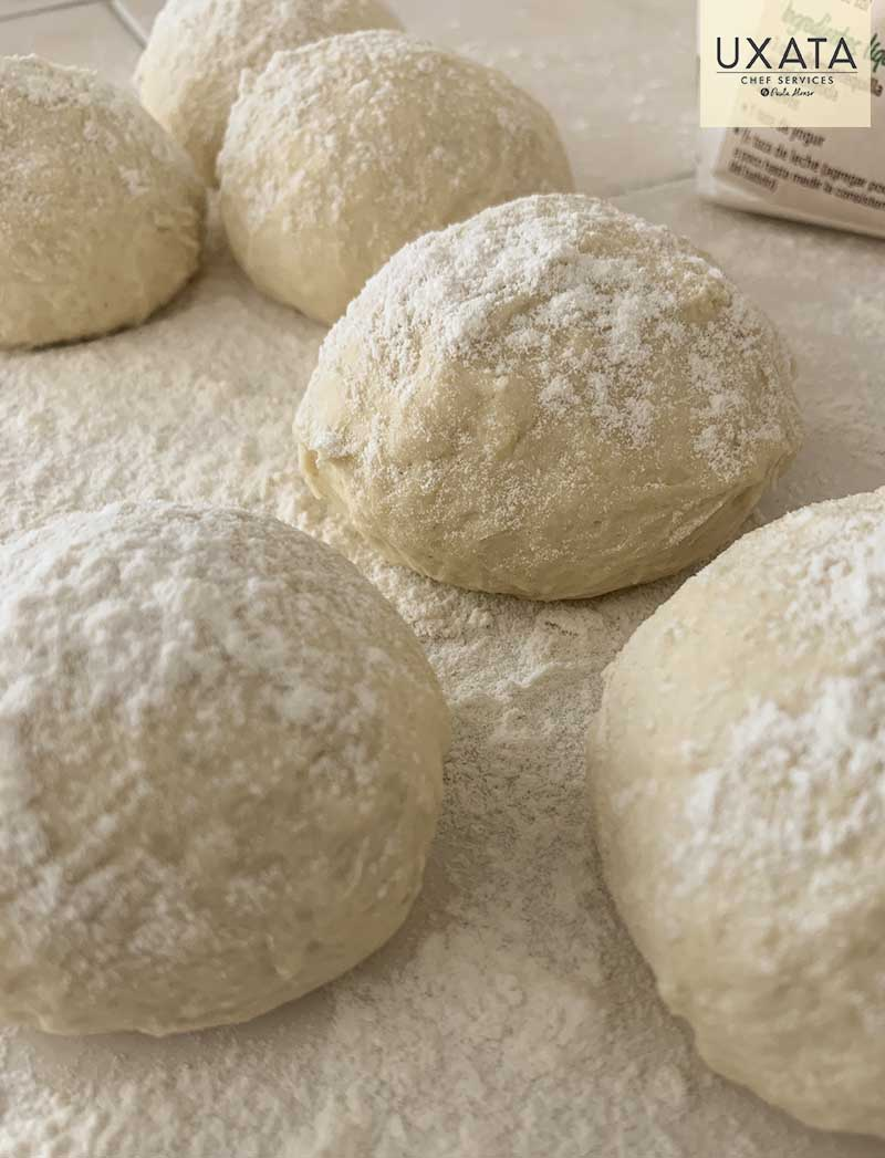 Six homemade pita bread buns sprinkled with flour, by UXATA Private Chef Services, Tankah, Riviera Maya.