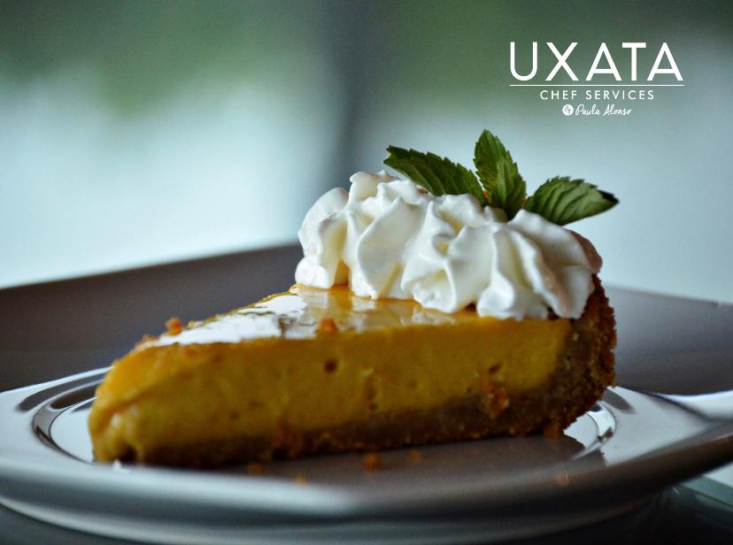 Mango pie with whipped cream and mint leaves on a plate, by UXATA Private Chef Services