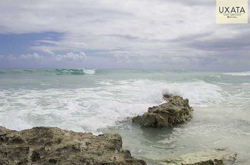 Rocky coast, turquoise sea and sky in Paamul