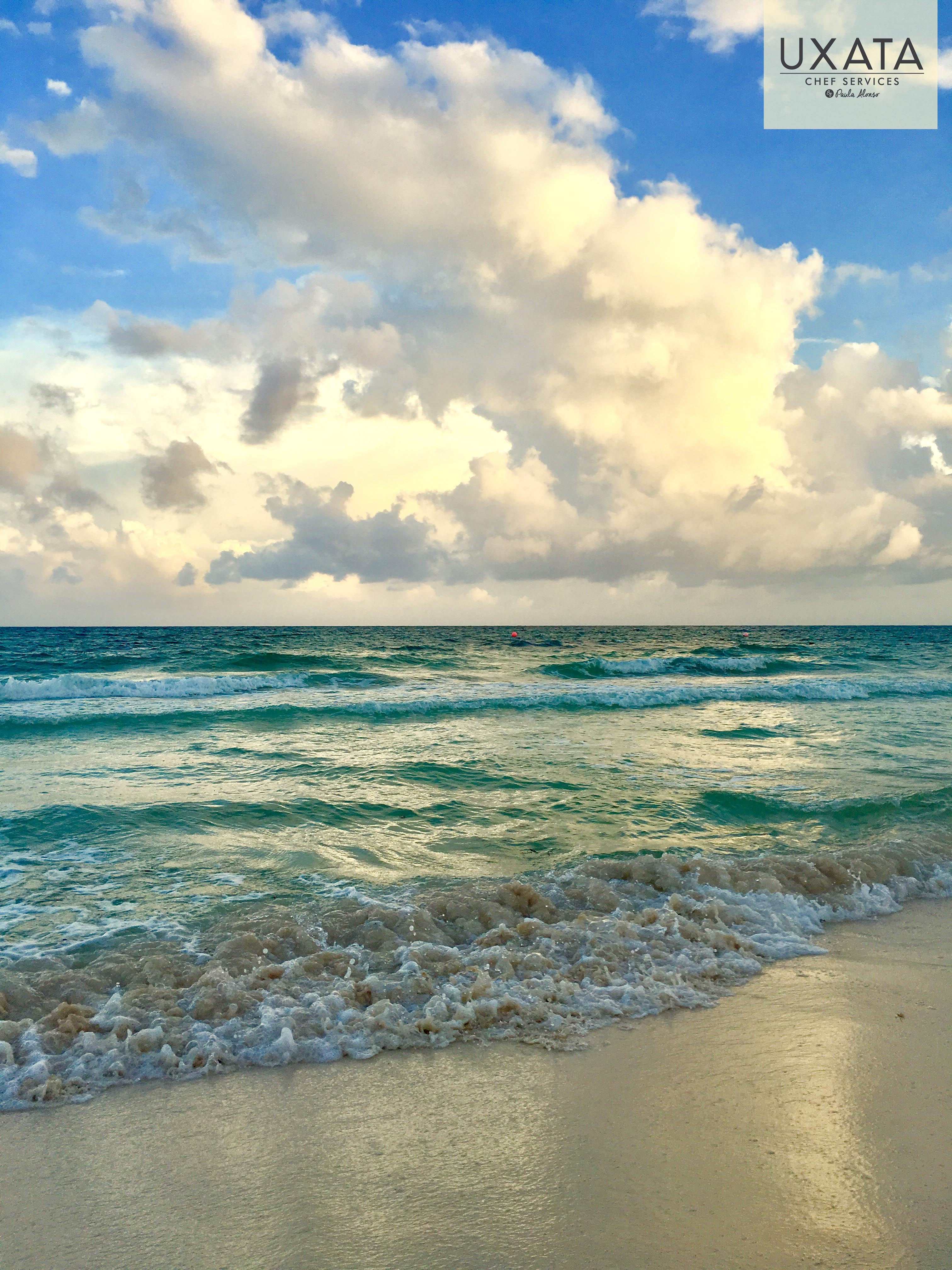 White sand and turquoise caribbean water in the coast of Puerto Morelos Riviera Maya by UXATA Chef Services