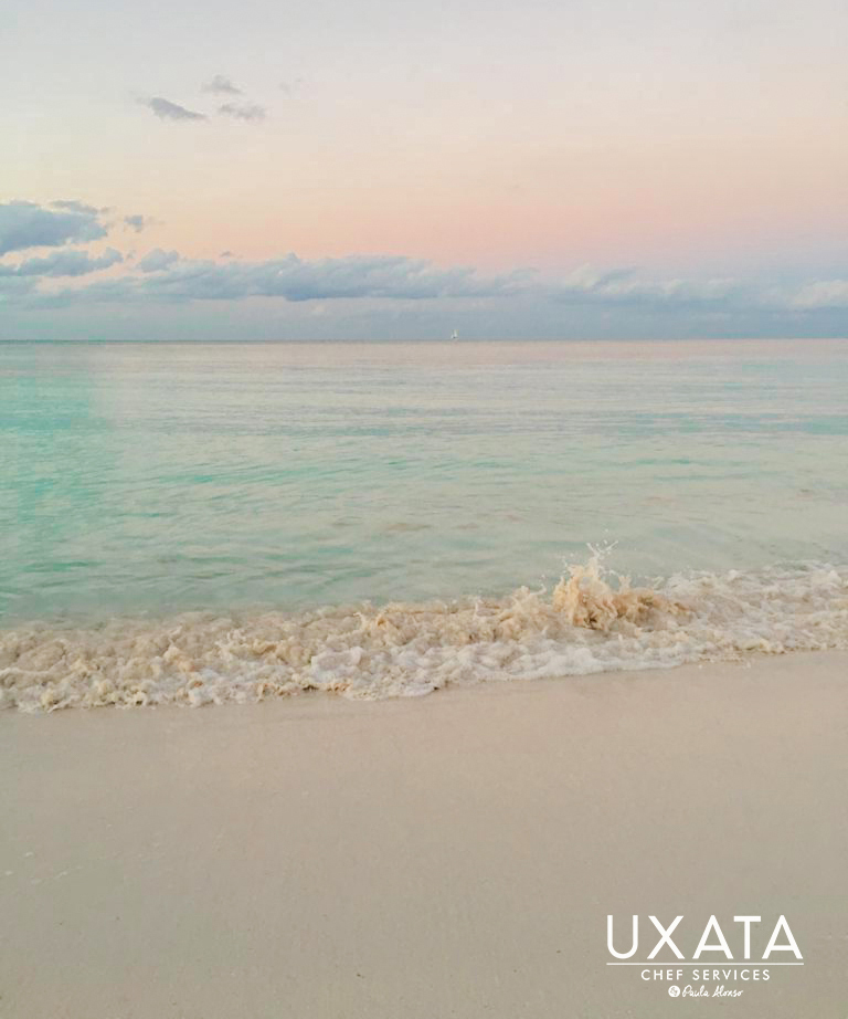 Sand and crystal clear waters on the coast of Punta Maroma, Riviera Maya, Mexico.