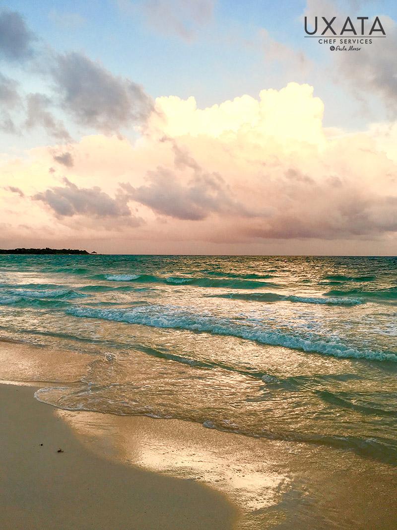 Sunset sun reflected off the coast of Tankah beach, Riviera Maya, Mexico.ters of the Tankah cove, Riviera Maya, Mexico