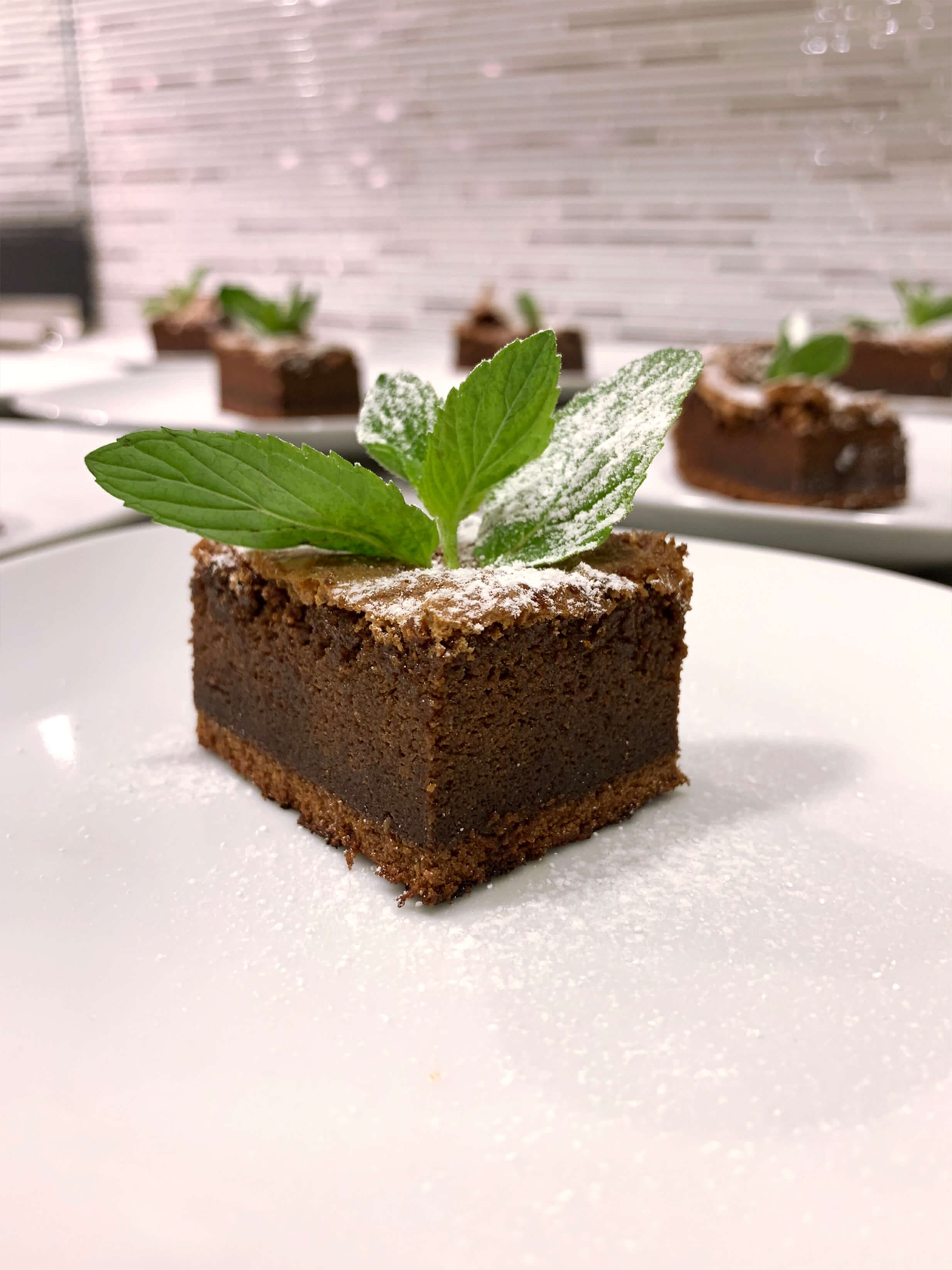 Chocolate brownie with mint leaf decoration, by UXATA Chef at home Riviera Maya.